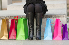 Parts of body of young woman with shopping bags Royalty Free Stock Photos