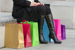 Parts of body of young woman with shopping bags Stock Photo