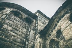 Parts of a brick wall of an ancient church stock photography