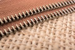 Parts of the zipper on linen canvas  background Royalty Free Stock Photo