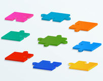 Parts of colorful puzzles on a white background. S Royalty Free Stock Image