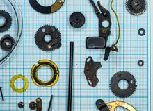 Parts old retro film SLR camera on graph paper. Parts are completely disassembled old retro film SLR camera on graph paper, close-up Royalty Free Stock Image