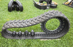 Parts of construction and agriculture machine with rubber crampo Stock Images