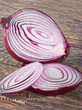 Parts of cut purple onion Stock Photography