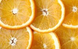 Parts d'oranges Images stock