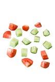 Parts d'un concombre et d'une tomate Photographie stock libre de droits