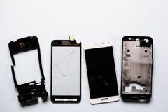 Parts of damaged broken smartphones stock photography