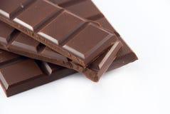 parts de chocolat Photos stock