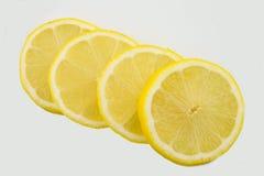 Parts de citron d'isolement Photographie stock