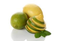 Parts de citron et de limette Photographie stock