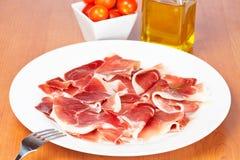 Parts de jambon espagnol Photographie stock
