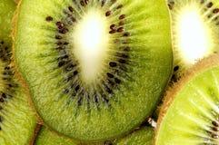 Parts de kiwi juteux Photographie stock libre de droits