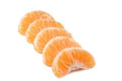 Parts de mandarine Photographie stock
