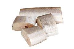 Parts de merluches de poissons crus images stock