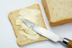 Parts de pain avec du beurre Photo stock