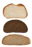Parts de pain sur le blanc Photographie stock libre de droits
