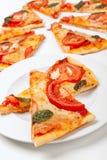 Parts de pizza Photographie stock