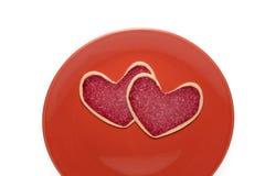 Parts de salami de plaque rouge Photographie stock