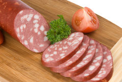 Parts de saucisse de salami images libres de droits