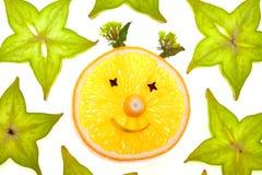 Parts de Starfruit (carambolier) avec le visage orange Photo stock