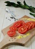 Parts de tomate Image stock
