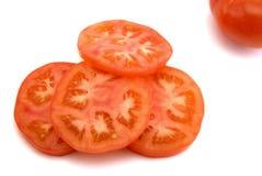 Parts de tomate Photographie stock libre de droits