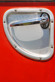 Parts of Fire Engine. Parts of old Fire Engine - details with chrome clench and red surface royalty free stock image