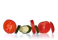 Parts fraîches de concombre et de tomate photo stock