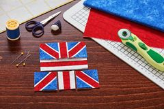 Parts of future pincushion viewing like union jack flag, sewing accessories stock image