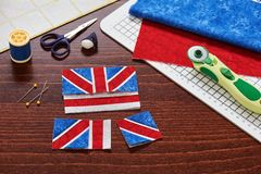 Parts of future pincushion viewing like union jack flag, sewing accessories stock photography