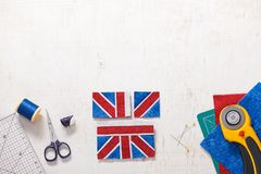 Parts of future pincushion viewing like union jack flag, sewing accessories royalty free stock images