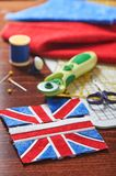 Parts of future pincushion viewing like union jack flag, sewing accessories royalty free stock photo