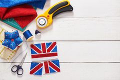 Parts of future pincushion viewing like union jack flag, sewing accessories stock images