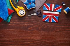 Parts of future pincushion viewing like union jack flag, sewing accessories stock photos