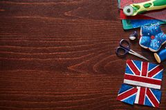 Parts of future pincushion viewing like union jack flag, sewing accessories royalty free stock photography