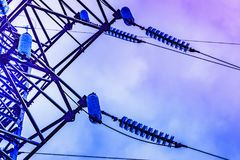 Parts of high voltage electricity pylons and transmission power stock photo