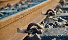 Parts of an iron made railway tracks unique photo. An parts of a metallic railway tracks in the afternoon unique photo stock photo
