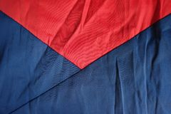 Parts of jammed navy and red fabrics sewn together. Parts of jammed navy and red cotton fabrics sewn together Royalty Free Stock Photos