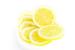 Parts juteuses fraîches de citron sur le blanc Photographie stock libre de droits
