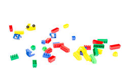 Parts of Lego scattered. On a white background royalty free stock photography