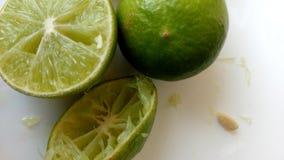 Parts of lemon. 2 parts of lemon and lemon seed on white background Stock Image