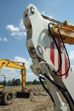 Parts of mechanical shovels. On building site Stock Photography