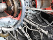 Parts of the old aircraft engine. Nuts connecting tubes, nozzles, cylinders, insulation of the combustion chamber. Mechanic abstract airplane assembly stock images