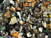 Parts of old optical drives as industrial waste background Stock Image