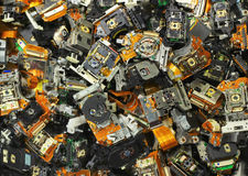 Parts of old optical drives as industrial waste background Stock Photo