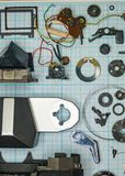 Parts old retro film SLR camera on graph paper. Parts are completely disassembled old retro film SLR camera on graph paper, close-up Stock Image