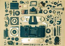 Parts old retro film SLR camera on graph paper Royalty Free Stock Photography