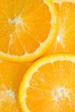 Parts oranges de fruits. photos stock