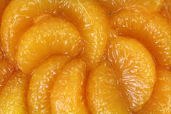 Parts oranges en jus Images stock