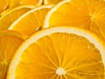 Parts oranges juteuses Image stock